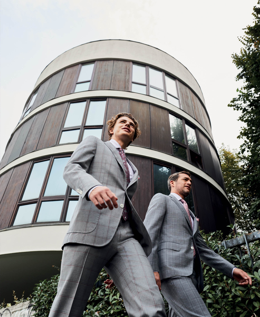 Giff of two models walking wearing ISAIA's new spring summer 2019 collection