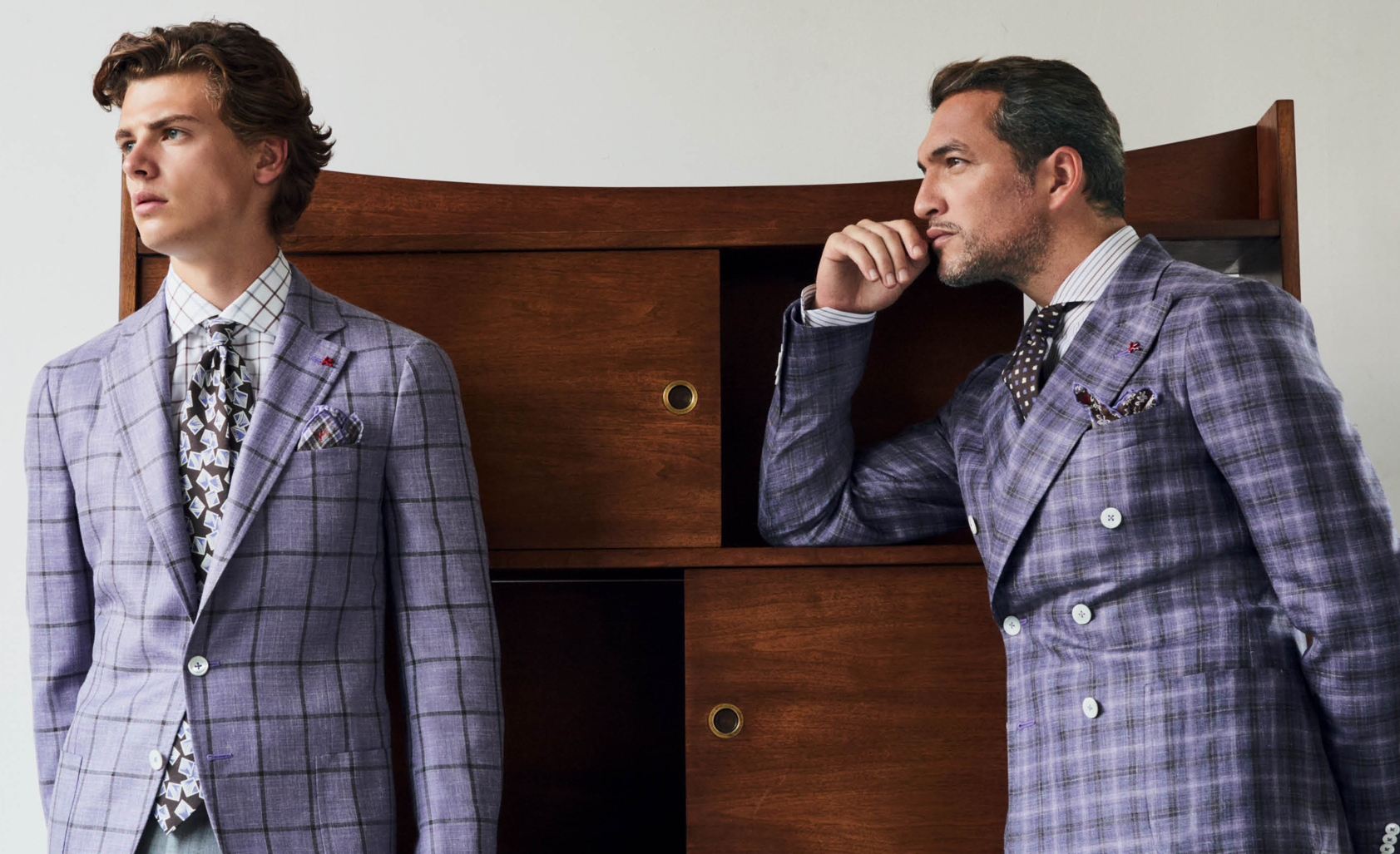 Two men wearing lavendar isaia sport jackets from the Spring Summer 2019 Collection
